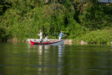 Group fly fishing from drift boat on White River