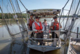Fisheries crew of the US Fish and Wildlife boat, The Magna Carpa, on Missouri River