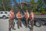 Crew of the U.S. Fish and Wildlife Service boat, The Magna Carpa, safety briefing