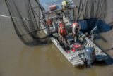 U.S. Fish and Wildlife Service boat, The Magna Carpa, with catch of invasive carp