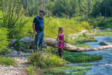 Older man with young girl fishing
