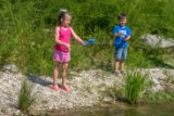 Little girl and boy fishing