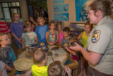 Visitor center program with FWS employee holding turtle