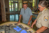 Visitor services specialist shows visitor 3D map