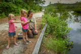 FWS Visitor services staffer shows young girls how to fish
