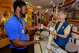 FWS volunteer with visitor in gift shop