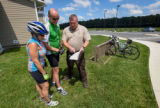 FWS Staffer shows bicyclists a map