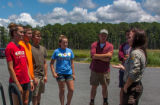 FWS staff talks to group of high school students at kiosk