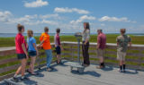 FWS staff talks to group of high school students on viewing platform