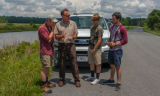FWS staff talks to group of young birdwatchers at truck