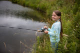 Young girl fishing