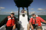 Refuge staff in Service boat