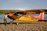 Small Airplane on River Gravel