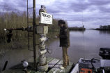 Checking oil well on Delta National Wildlife Refuge