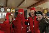 M/V Tiglax first mate Billy Pepper assists with Survival suits