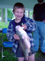 Boy holding big fish