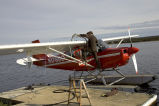 Kanuti floatplane being fueled at VOR Lake in Bettles