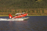 USFWS floatplane  departs Grayling Lake on the Dalton Highway