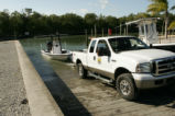U.S. Fish and Wildlife employees launching boat