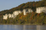 Limestone cliffs and autumn trees on the Big Muddy