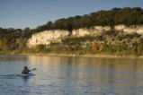 Man kayaking toward cliffs on the Big Muddy