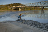 Man kayaking to boat ramp on Big Muddy