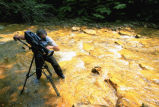 Videographer recording acid mine runoff