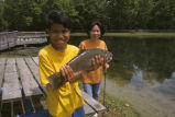 Son showing fish he caught