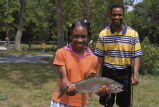 Father and Daughter show Rainbow Trout