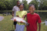 Son and Daughter show trout that caught with father