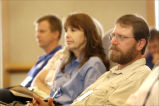 People concentrating on speaker during meeting at the National Conservation Training Center
