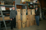 U.S. Fish and Wildlife Service volunteers standing next to new Wood Duck houses at St. Marks...