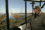 U.S. Fish and Wildlife Service volunteer looks out from St. Marks National Wildlife Refuge...