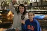 Children display items from craft fair at St. Marks National Wildlife Refuge.