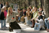 Female U.S. Fish and Wildlife Service employee entertains children on wildlife trail