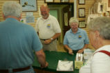 Volunteers help visitors.