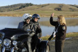 Sallie Gentry talks with visitors on a motorbike