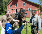 Visitors with horse logger